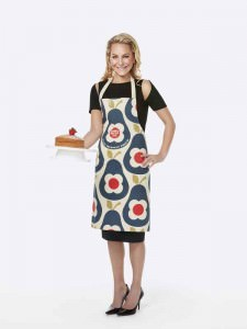 Emma Spencer wearing the Orla Kiely Sport Relief 2016 apron available from HomeSense and TK Maxx stores